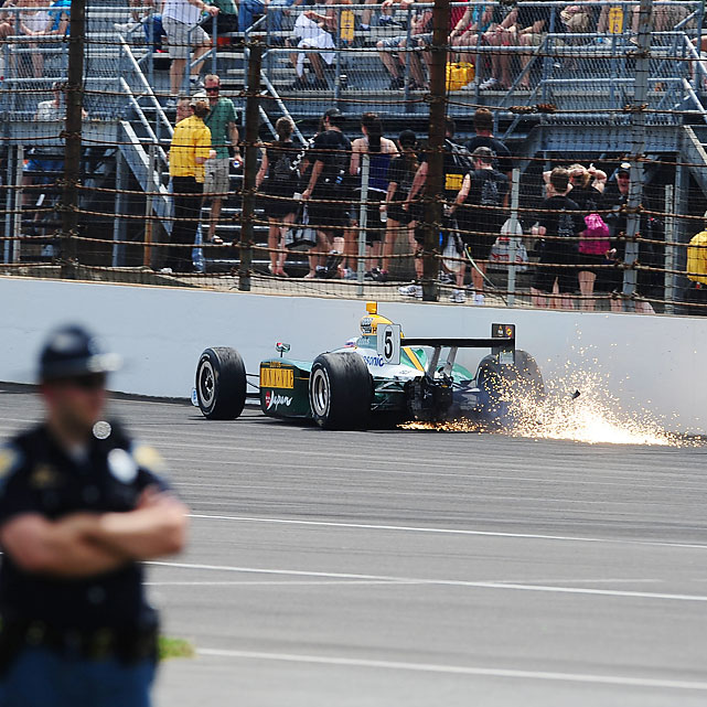 Sparks fly as Japanese driver Takuma Sato hits the wall.