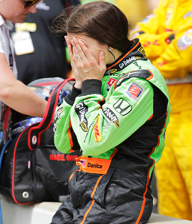 Danica Patrick, who led for part of the race, covers her face in the pits after finishing 10th in the Indianapolis 500.