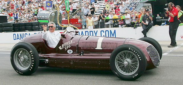 Racing legend Mario Andretti, 1969 Indy 500 winner, drives a classic car before the race.
