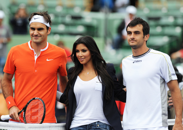 Kim poses with Roger Federer and Florent Serra before their match at the Sony Ericsson Open at Key Biscayne, Fla.
