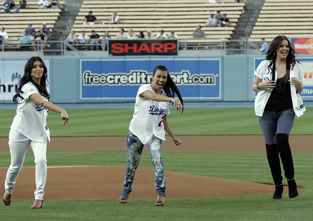 Kim, Kourtney and Khloe throw out the ceremonial first pitch prior to a Dodgers-Nationals game in Los Angeles.