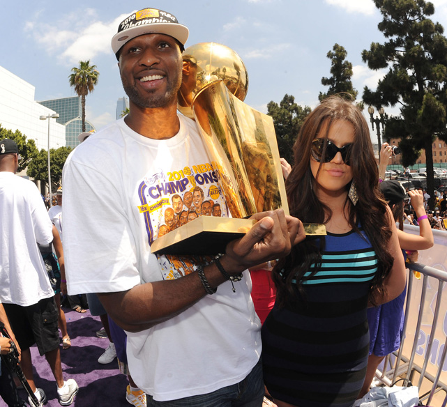 Lamar Odom celebrates with his wife, Khloe, during the Los Angeles Lakers Championship Parade in June 2010.