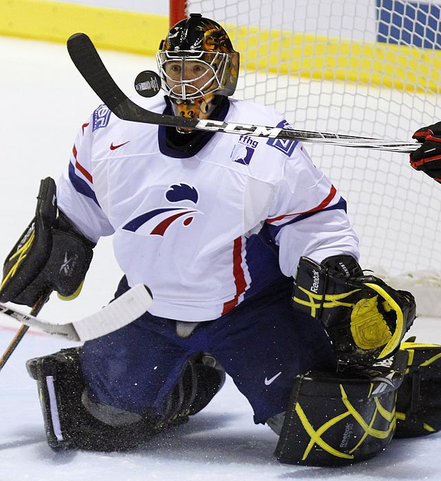French netminder Fabrice L'Henry keeps a close eye on the puck during the preliminary round of the ice hockey world championships in Kosice, Slovakia. A booking error sent the French team to Poland instead of Slovakia, but L'Henry remained sharp.