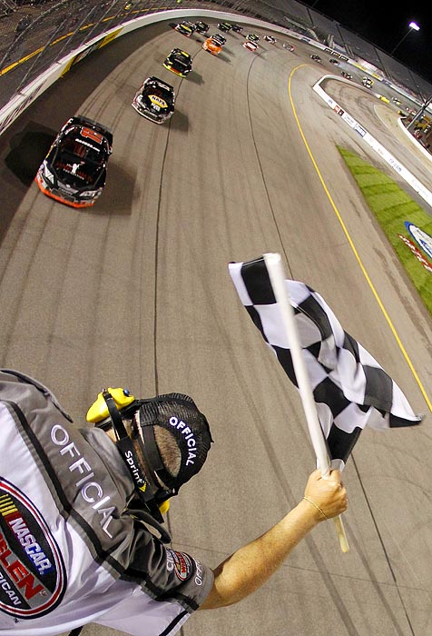 Denny Hamlin takes the checkered flag at his namesake event (the Denny Hamlin Short Track Showdown) at Richmond International Raceway on April 28.