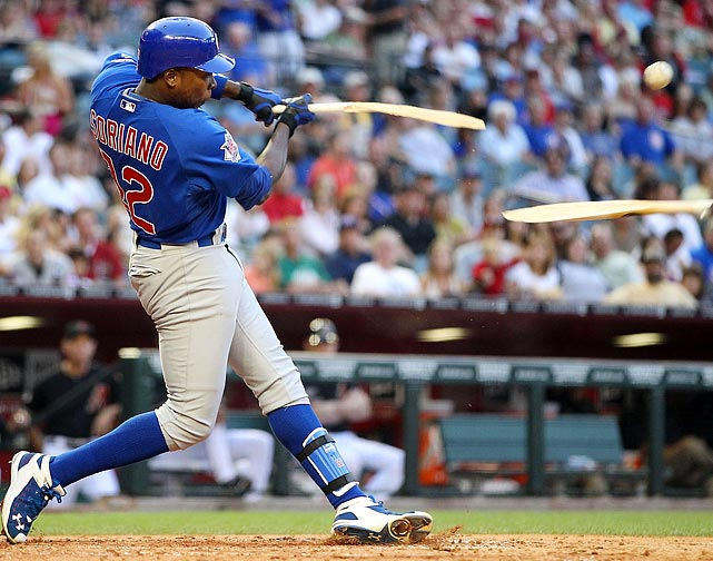 Unlikely major league home run leader Alfonso Soriano (11 home runs) breaks his stick as he bats against the Arizona Diamondbacks on April 30. The Cubs would go on to win 5-3.