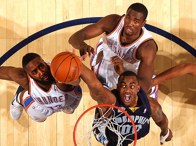 Grizzlies forward Darrell Arthur battles for a rebound against Thunder guard James Harden (left) and forward Serge Ibaka (top) during the Grizzlies' 114-101 victory over the Thunder.