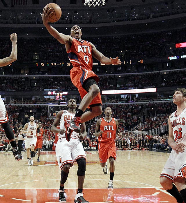 Filling in for an injured Kirk Hinrich, Jeff Teague (center) played 45 minutes and scored 10 points as the Hawks defeated the Bulls 103-95 in Game 1 of the Eastern Conference semifinals.