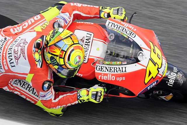 Ducati's Valentino Rossi leans into a turn during the MotoGP free practice session of the Portugal Grand Prix on April 29. Rossi went on to finish fifth.