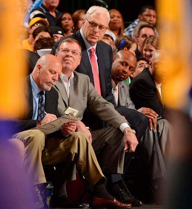 Lakers head coach Phil Jackson looks on one last time as the Dallas Mavericks sweep his Lakers in the Western Conference semifinals. Jackson said the Lakers' 122-86 loss in Game 4 was his last as a coach. Jackson's 11 titles and .704 career-winning percentage put him in rarefied air among NBA coaches.
