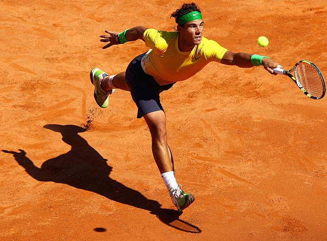 Master of clay, Rafael Nadal reaches for a ball during his quarterfinal match against Croatia's Marin Cilic in the Rome Masters tournament. Nadal would go on to defeat Cilic 6-1, 6-3 to advance to the finals against Novak Djokovic.