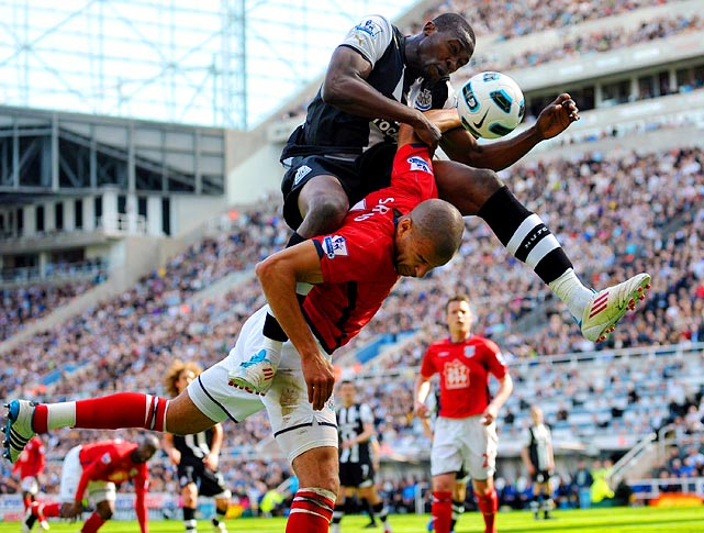 Newcastle United's Shola Ameobi (top) challenges West Bromwich Albion's Steve Reid during a 3-3 draw on May 22.