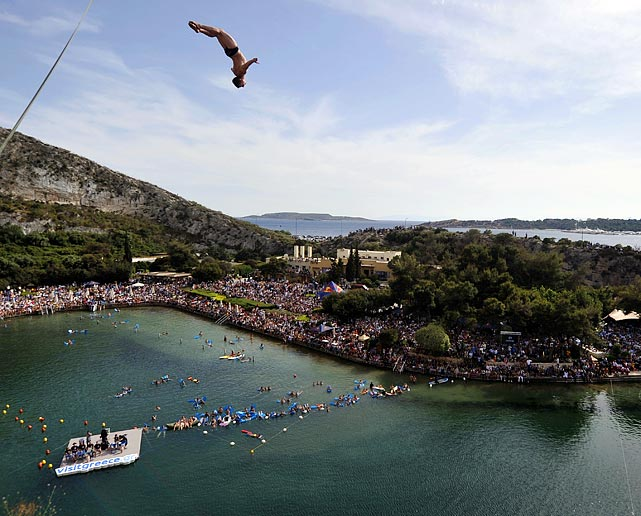 Displaying no fear, an athlete dives into Lake Vouliagmeni -- a body of water south of Athens -- during the Red Bull Cliff Diving World Series on May 22.