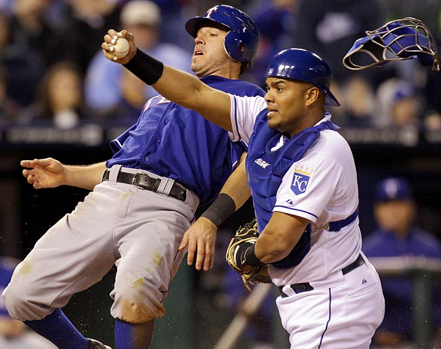 Kansas City Royals catcher Brayan Pena pleads his case to the umpire after Texas Rangers second baseman Ian Kinsler scores in the 11th inning of a Rangers-Royals game on May 18. Pena's plea was denied, and the Rangers went on to win 5-4.