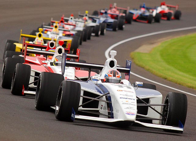 A train of Indy cars warm up the Indianapolis Motor Speedway during the Freedom 100, the biggest race of the Indy Lights season, on May 27.