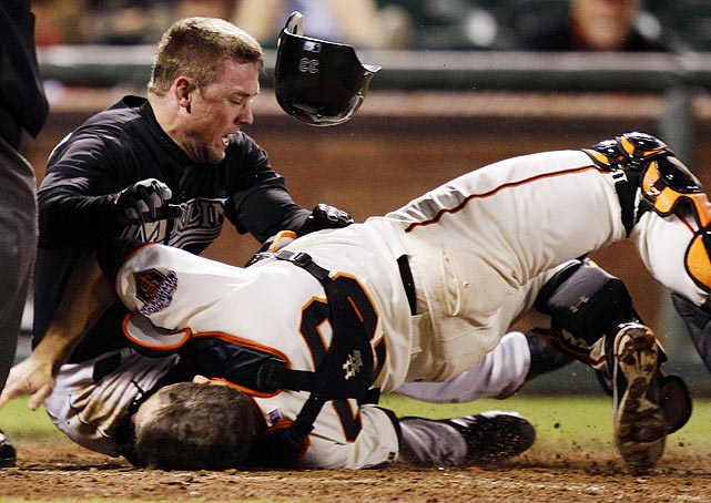 Buster Posey's (bottom) leg bends in a way legs never should after this collision with Marlins outfielder Scott Cousins in the 12th inning of the Marlins' 7-6 victory on May 25. The collision broke Posey's leg and ended his 2011 season.