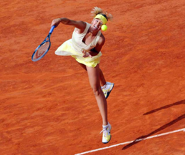 Maria Sharapova serves during her fourth round French Open match against Agnieszka Radwanska. Sharapova would hold on to defeat Radwanska 7-6, 7-5.