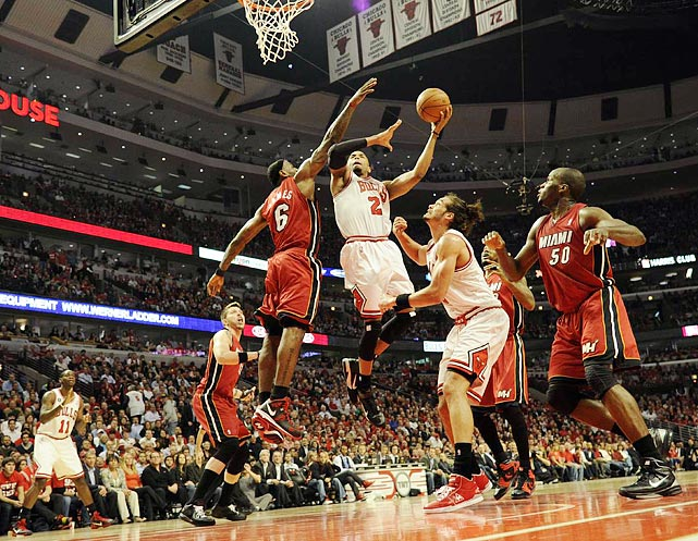 LeBron James (6) contests a shot attempt from Taj Gibson during the Heat's 83-80 victory over the Bulls in the series-clinching Game 5 of the Eastern Conference finals. James would finish the game with 28 points, 11 rebounds, six assists, three steals and two blocked shots.