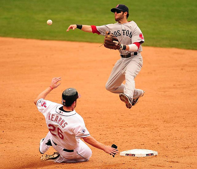 Red Sox second baseman Dustin Pedroia makes a leaping throw to first during the Red Sox's 14-2 win over the Indians on May 25. Pedroia also did damage with his bat, going 2 for 6 with a home run and three RBIs.