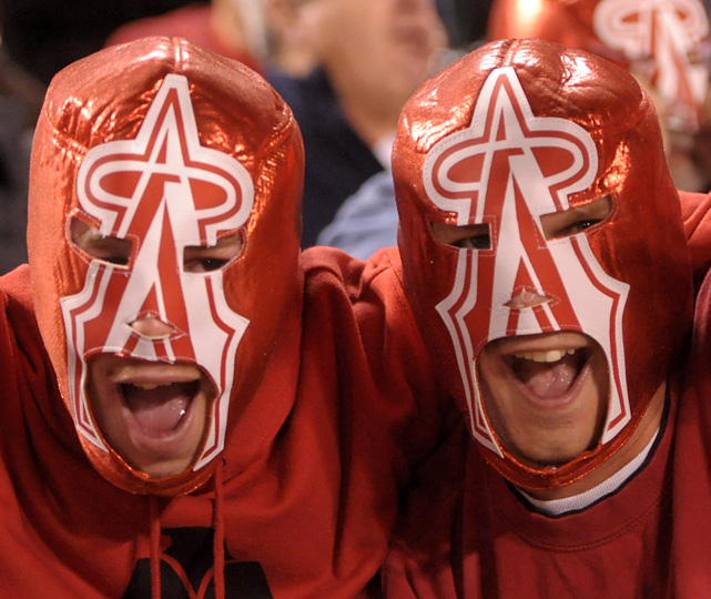 Fans of the Anaheim Angels made history Tuesday night by breaking the Guinness World Record for the largest gathering of people wearing costumed masks (40,128). Here are some photos from the stands.