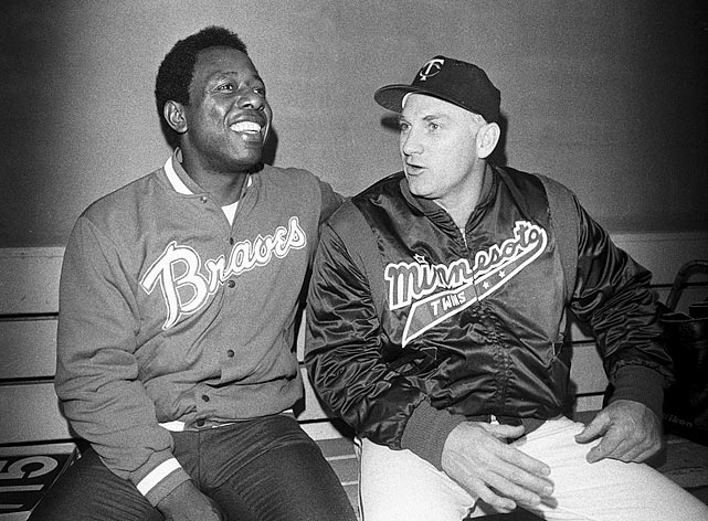Then home run king Hank Aaron and Killebrew (then fifth in career homers) sit in the dugout after engaging in a home run hitting contest before an Atlanta-Minnesota exhibition game. Each hit three homers during the contest.