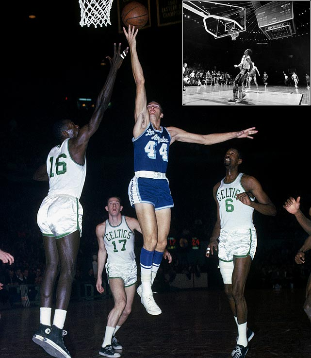 The Logo was a postseason force, including being named the 1969 Finals MVP even though the Lakers lost the series to Boston. Two more signature moments: his steal and game-winning layup to give the Lakers a 2-1 series lead in 1962 (Boston won it in seven); and his buzzer-beating 60-footer (inset) to force overtime against the Knicks in '70 (New York won the game and the series, forcing West to wait two more years for his first and only title).