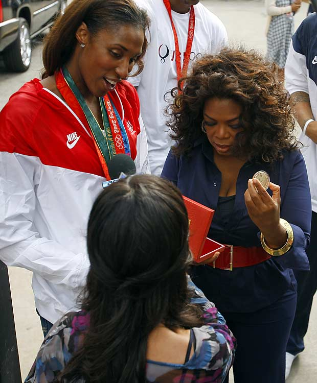 Lisa Leslie also partook in the Millennium Park festivities, showing off her gold medal.