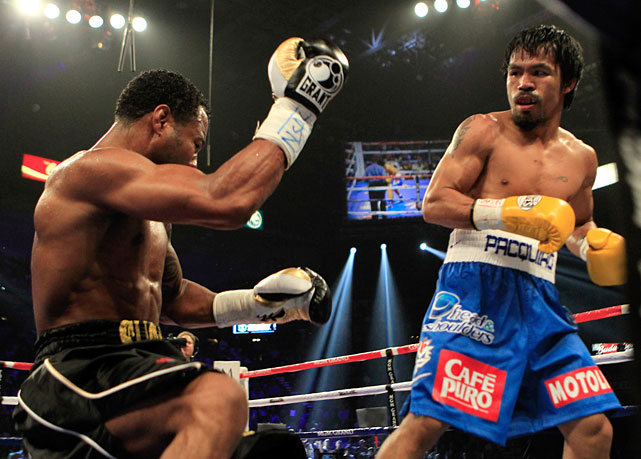 Mosley is knocked down in the third round.