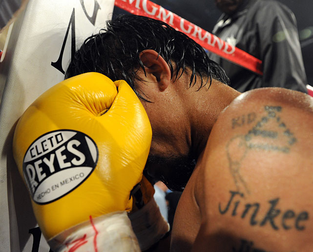 Pacquiao kneels in prayer after defeating Mosley to defend the WBO welterweight title he won from Miguel Cotto in 2009.