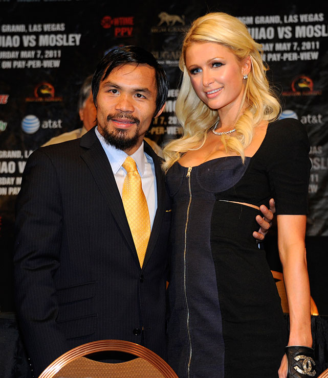 Pacquiao poses with Paris Hilton following the post-fight press conference.