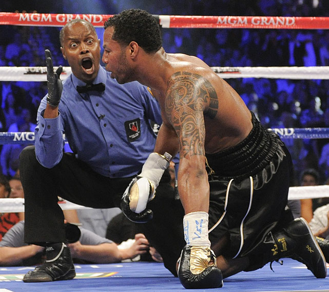 The veteran referee Bayless issues the count on Mosley after the challenger was knocked down.