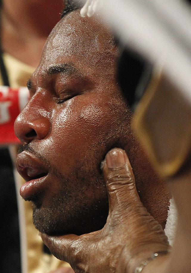 Mosley is worked on by his trainers between rounds.