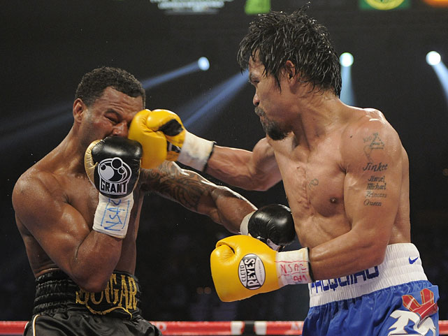Pacquiao connects with a punch on Mosley.