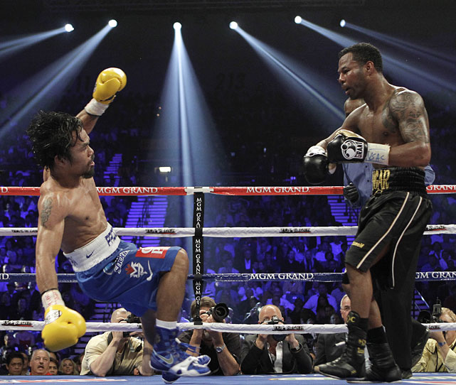 Pacquiao is knocked down by Mosley during the 10th round, though replays revealed it was actually a push.