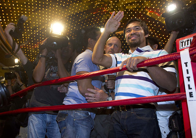 Manny Pacquiao waves to the crowd after arriving at the MGM Grand.