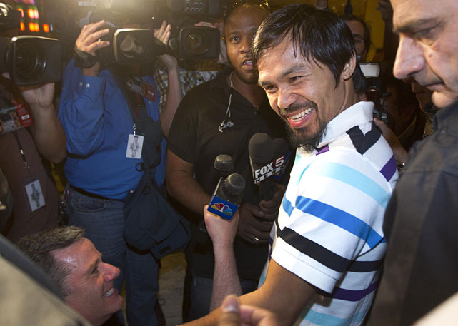 Pacquiao answers questions for members of the media after arriving at the MGM Grand.