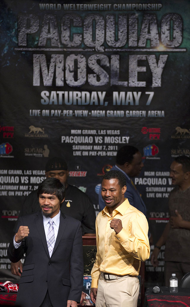 Pacquiao and Mosley pose for photos after their final pre-fight news conference.