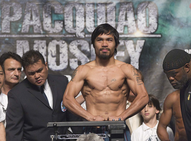 Pacquiao weighs in at 145 pounds for Saturday's fight.