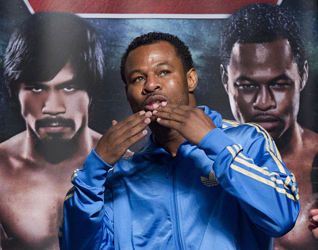 Mosley gestures to the crowd as he arrives for the weigh-in.