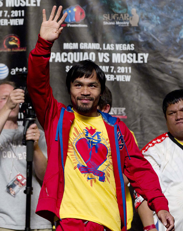 Pacquiao acknowledges the crowd as he arrives for the weigh-in at the MGM Grand.