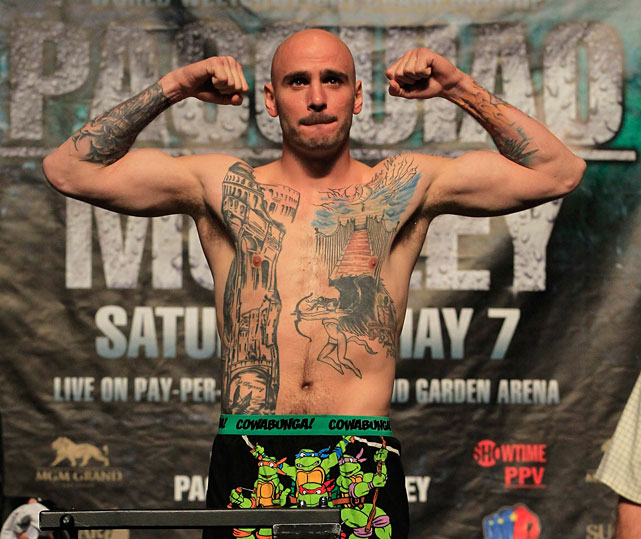 Former middleweight champion Pavlik steps on the scale before his super middleweight fight against Alfonso Lopez.