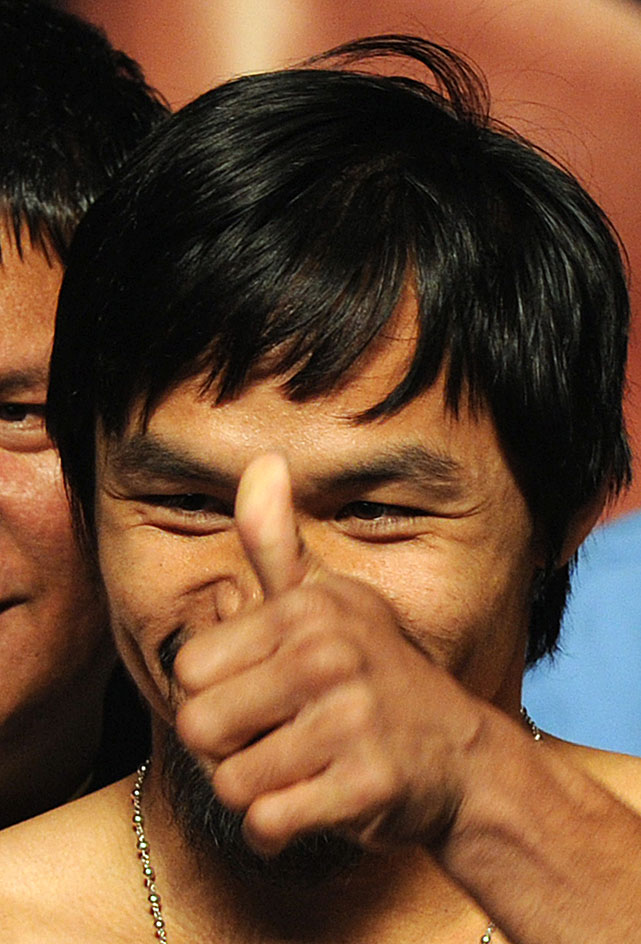 Pacquiao plays to the crowd after the official weigh-in.
