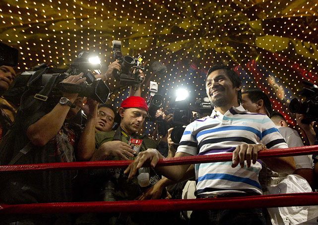 Manny Pacquiao turns to the crowd after arriving at the MGM Grand.