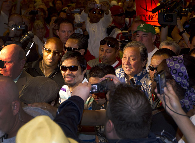Manny Pacquiao makes his way through the crowd upon arriving at the MGM Grand.
