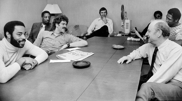 A relaxed bunch of Knicks -- (from left, around table) Walt Frazier, Jackson, Dick Barnett, Jerry Lucas, Dean Meminger and captain Willis Reed -- sit around a projector with Red Holzman at Madison Square Garden before the NBA Eastern division championship in 1973. The Knicks went on to win a championship that season.