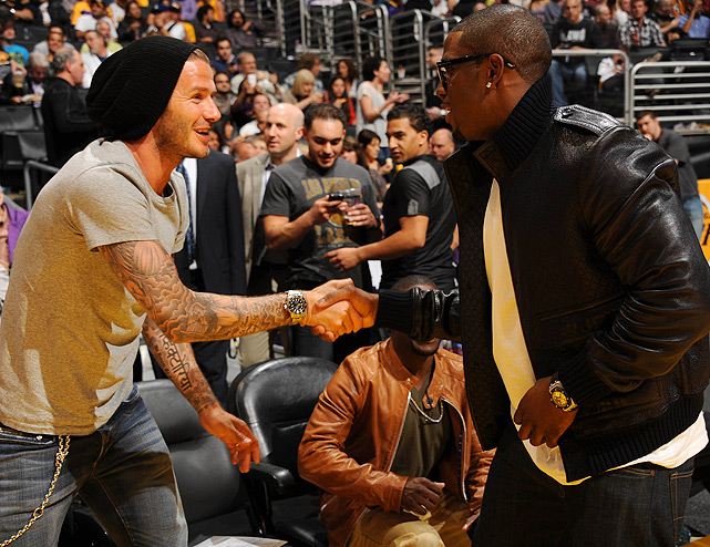 Bush & Becks! Reggie greeted international soccer superstar David Beckham during halftime of Game 5 of the Hornets-Lakers playoff series in Los Angeles.