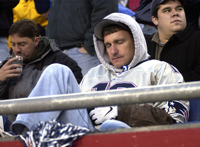 Even Tom Brady couldn't keep this Patriots fan's eyes open as he dozed off during a 2004 Patriots-Jets game.