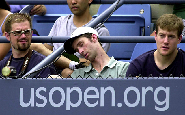 Even front row seats at the U.S. Open weren't enough to keep this fan's interest.