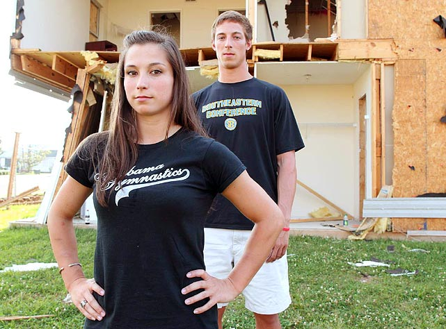 Gymnast Kayla Hoffman and her boyfriend, decathlete Michael Hughes, pose in front of her apartment building. Hoffman crouched in a door frame, with her purse pulled over her head, during the storm. A horrified Hughes drove toward Hoffman's building after hearing the storm had hit her area. He got stuck in traffic, left his car and sprinted toward her apartment to check on her.