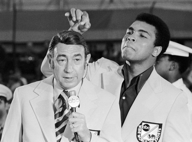 The heavyweight champion messes with the hair of the sports commentator before the start of the Olympic boxing trials. Cosell, known for his caustic style, was a celebrated and controversial figure. Ali, the trash-talking champion, was both beloved and vilified. It only makes sense that the pair had a good relationship.