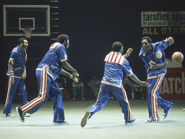The Globetrotters do their famous Magic Circle warm-up routine to the song  Sweet Georgia Brown  at the Palais des Sports in Paris. The team made a world tour during 1978.